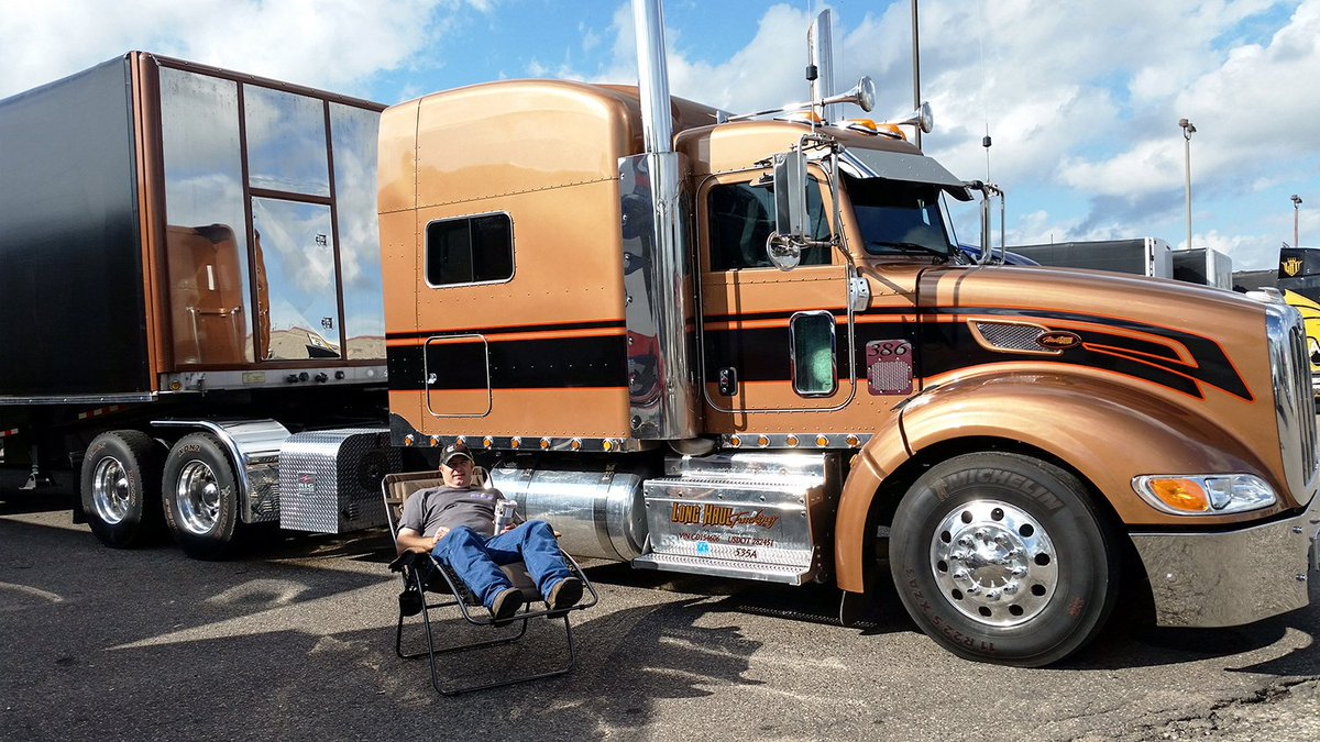 Owner Operator Mike Grim enjoying his winnings. Congrats on winning 1st place with the cool truck photos! #showchair