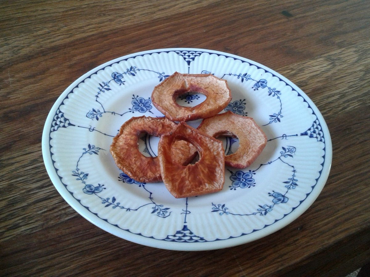 four apple rings on a plate