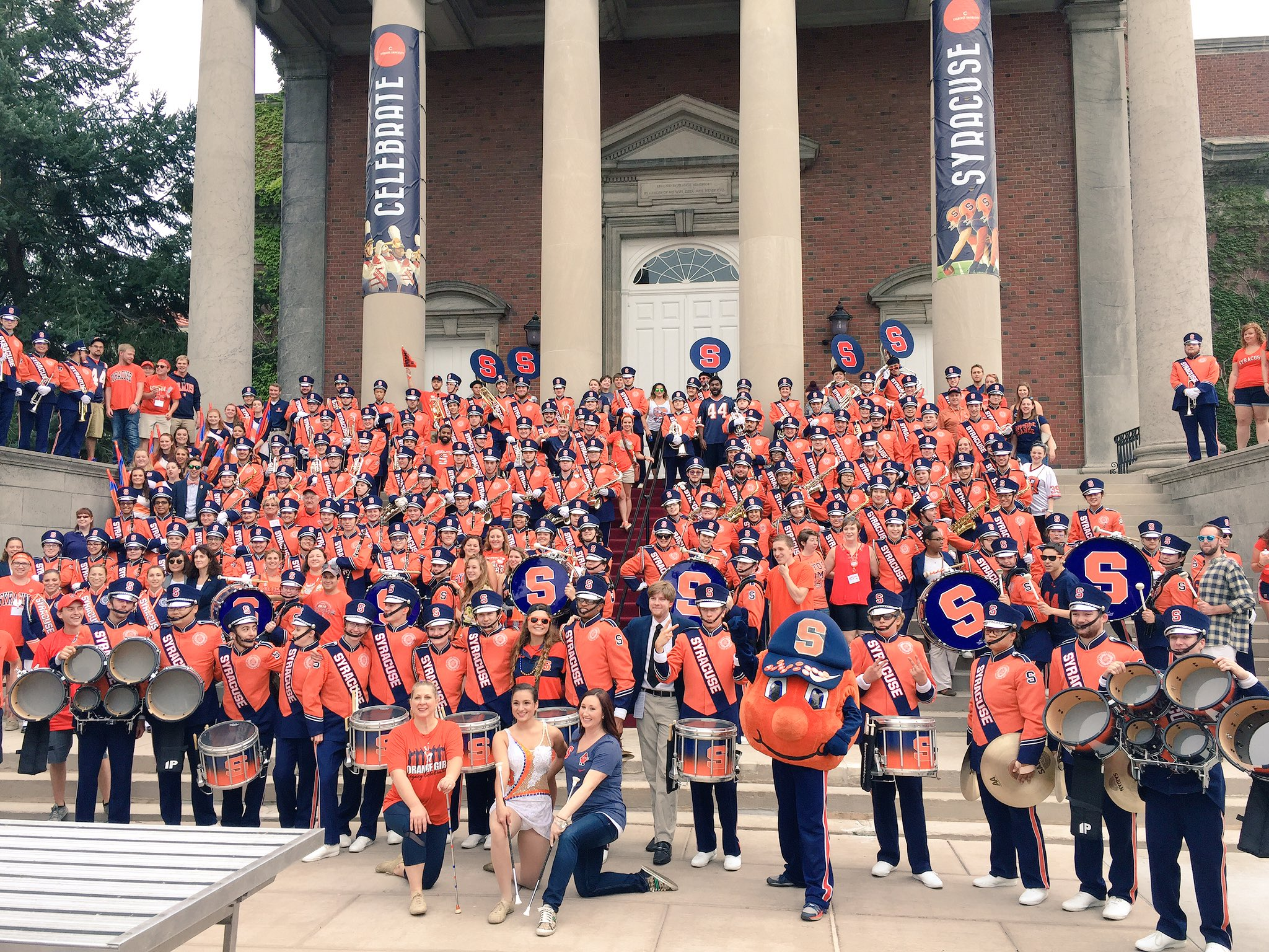 One of our favorite photos at #OrangeCentral every year! Current marching band with alumni band members! https://t.co/Df1Gucj8uI