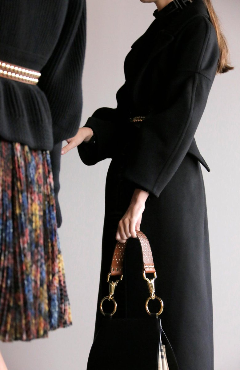 ad8b3c8f69fe sculptural coats and the bridle bag accented with rivets the burberry  september collection shop the show