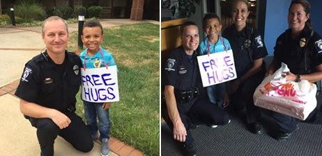Little boy gives Charlotte police officers 'free hugs' and donuts