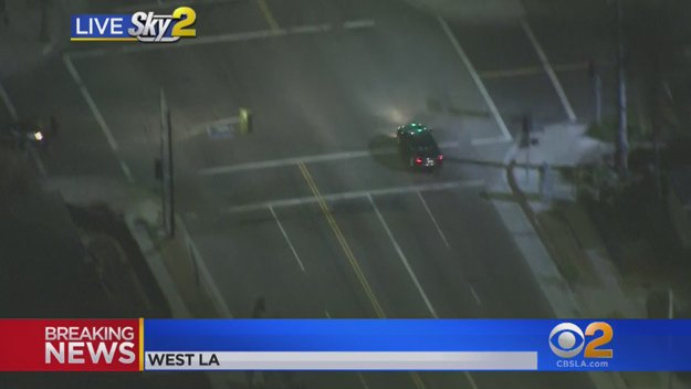 Stolen car suspect remains on surface streets but has run several red lights at high speed in West LA