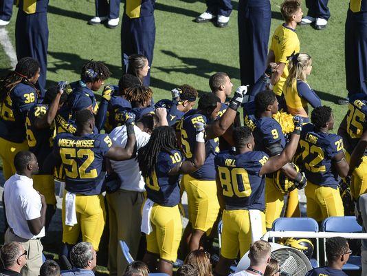 UM, MSU players raise fists during anthem