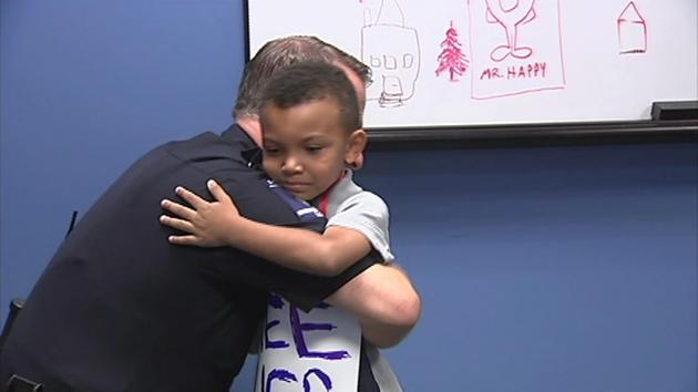 Boy in kindergarten scared by unrest gives cops in Charlotte 'free hugs'