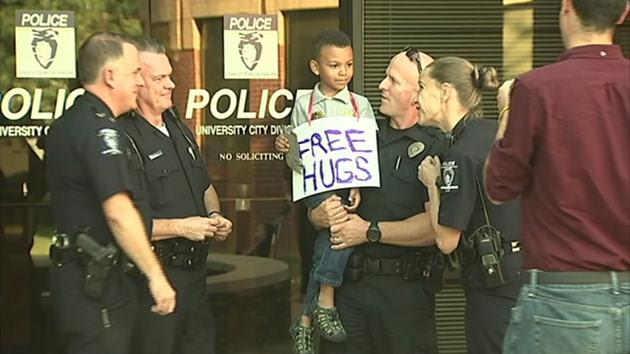 Boy in kindergarten scared by unrest gives cops in Charlotte 'free hugs'