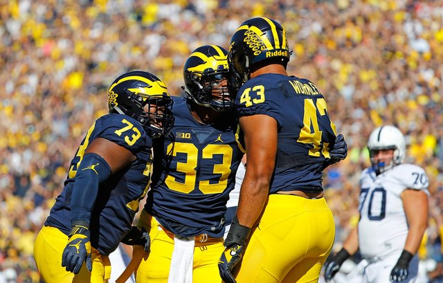 Michigan stays at No. 4, Michigan State falls to nine spots to No. 17 in latest AP Top 25.