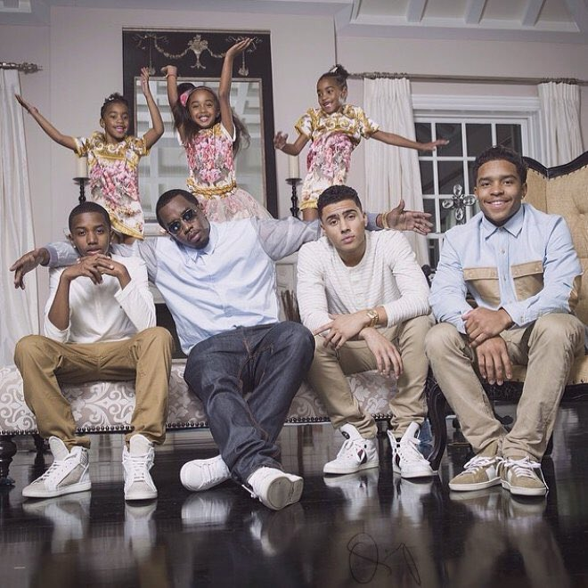 Diddy poses with his six children for family Christmas card