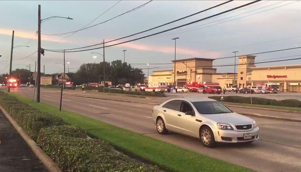 Houston police: 6 wounded in strip mall shooting; suspect dead.