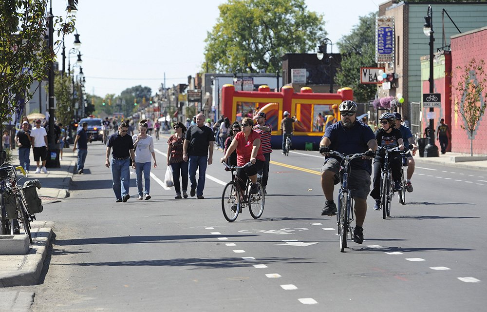 People on foot, bikes reclaim Motor City streets in Open Streets Detroit experiment.