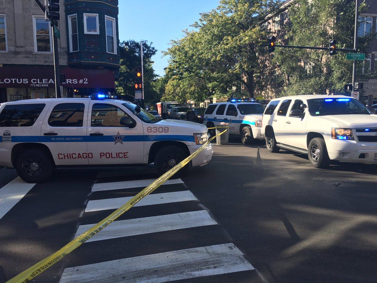 @Chicago_Police cars block body of biker killed @ Damen & Addison. Commuter witnesses shaken up @ABC7Chicago