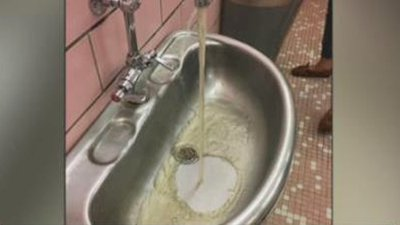 Student suspended after posting picture of discolored water in school bathroom
