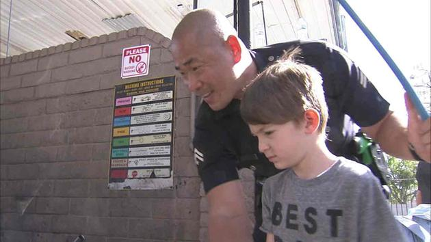 LAPD officers hold car wash to help boy get autism service dog