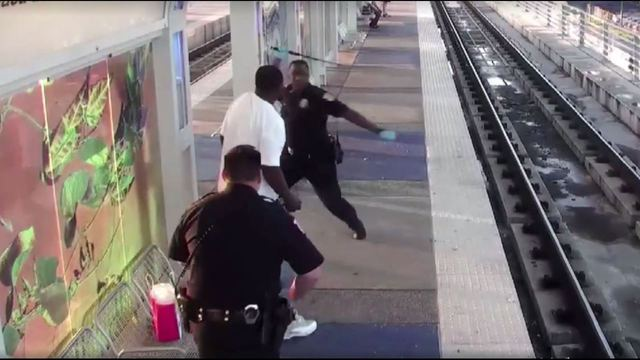 Transit police officer accused in beating resigns