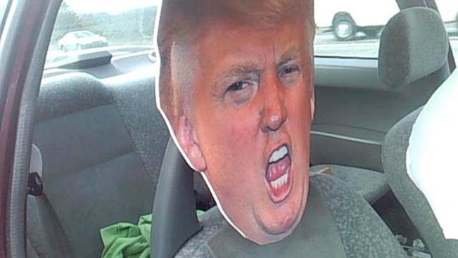 State trooper notices driver trying to sneak down carpool lane with huge Donald Trump head