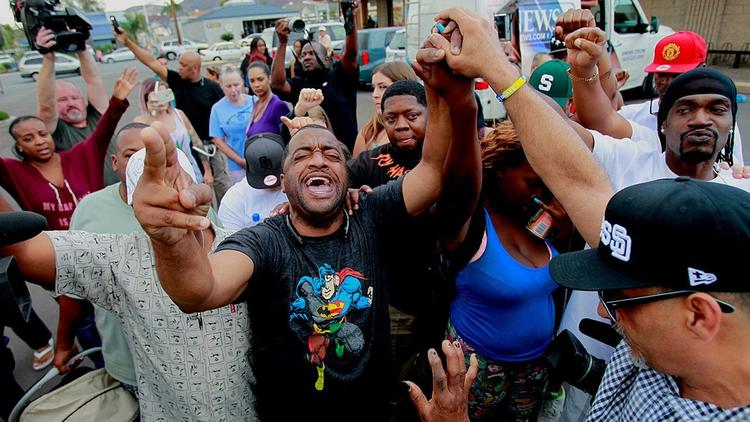 Fatal shooting of black man by El Cajon police sparks outrage, protests