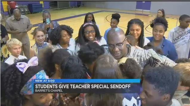 Students give their teacher a very special send off as he heads for Iraq. wmc5