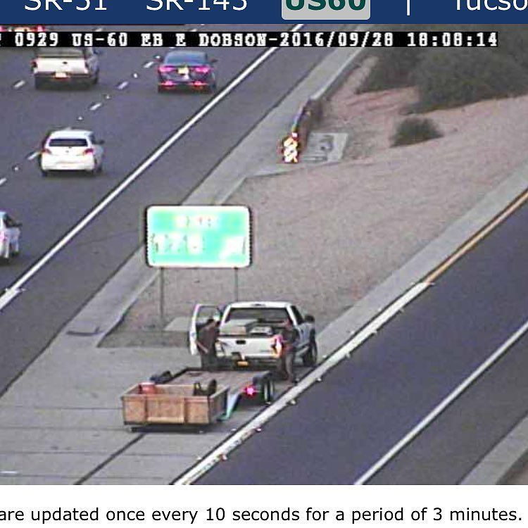Man in the wooden box at US 60 and Alma School now joined by a truck with a flatbed. The mystery continues! fox10p…