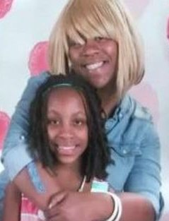 Community holds vigil to remember murdered mother