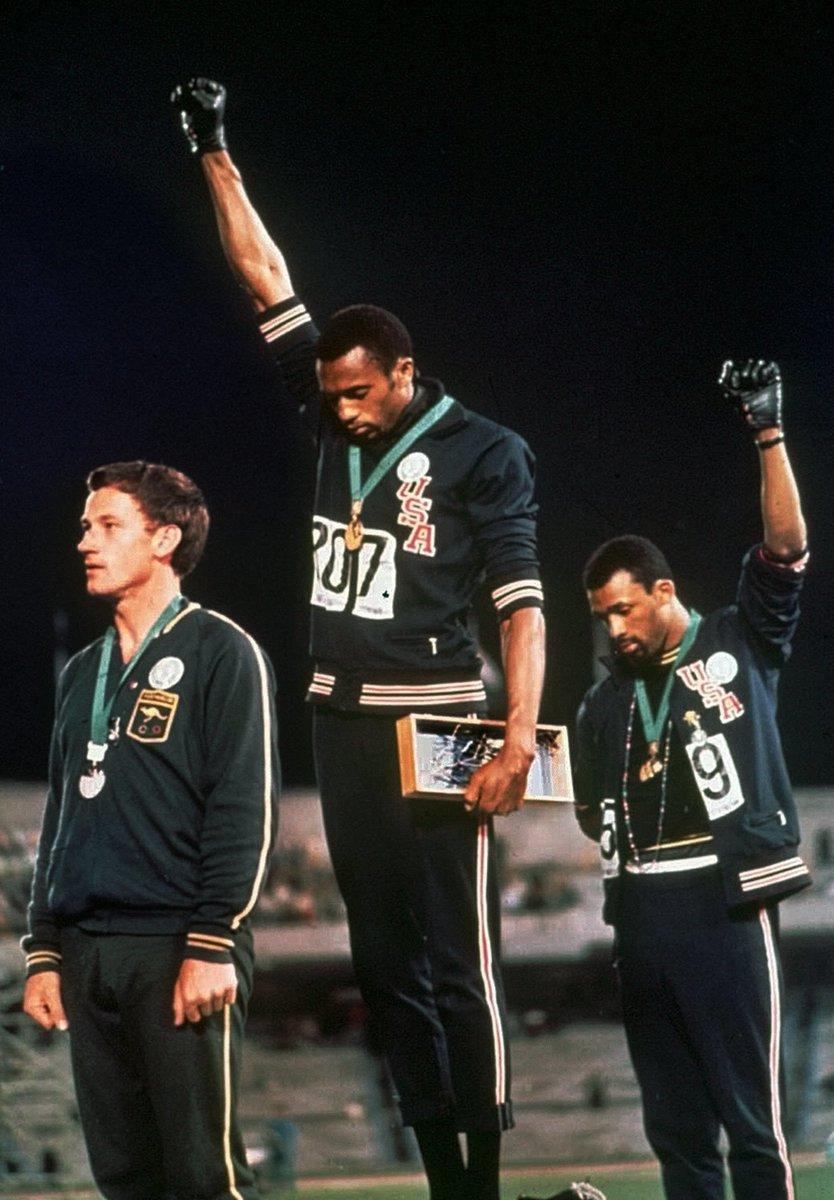 Raised-fist protesters from 1968 Olympics support quarterback Kaepernick