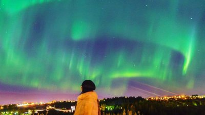 Iceland's capital plunges into darkness for stunning Northern Lights display -