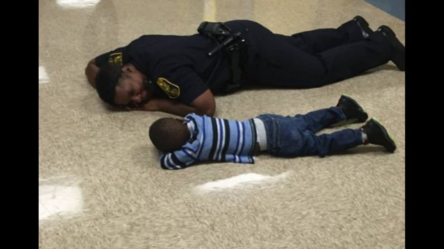Police officer comforts boy having bad day at school in Indiana