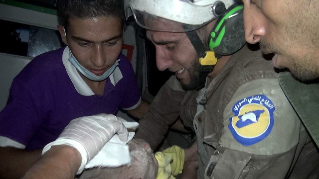 Rescuer sobs after he pulls month-old girl alive from rubble