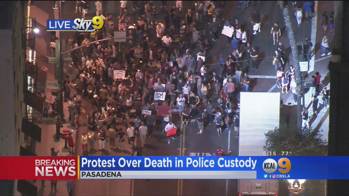 Protesters march in Pasadena after man's death in police custody earlier Friday.