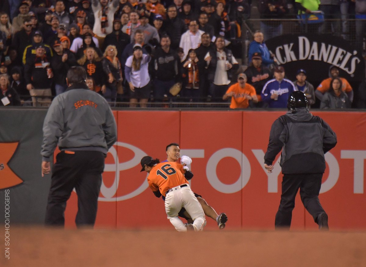 Angel Pagan takes down a fan who ran on the field during the Giants 9-3 win over the Dodgers Friday night