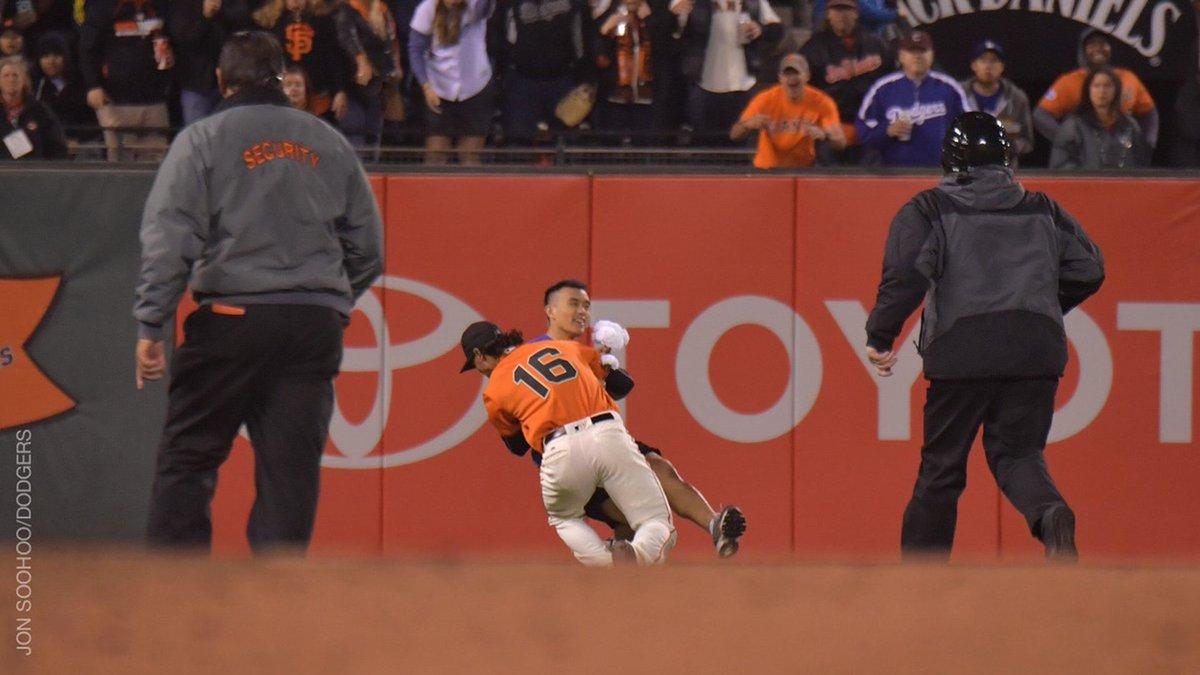 Giants outfielder caught on video body slamming fan on field. WATCH