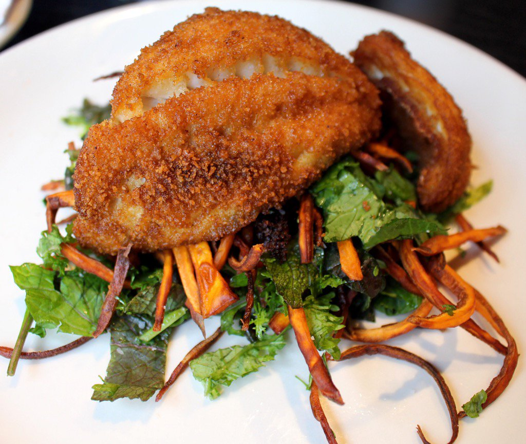 This weekends feature fried #triggerfish over sweet potatoes and mustard greens. #EatLocal #GravyRaleigh