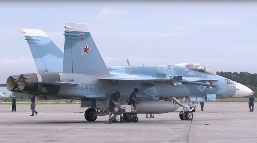 the us is painting their fa 18s to match the paint schemes of russian jets in syria