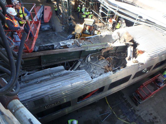 In this photo taken Oct. 5, 2016, during debris removal operations, a beam from the Hoboken Terminal is seen penetrating the roof of a rail car from NJT train 1614 which crashed at the terminal Sept. 29, 2016. (NTSB Photo by Mike Hiller)