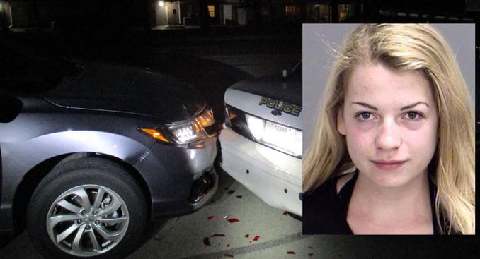 A woman says she was doing this when she crashed into the back of a police car