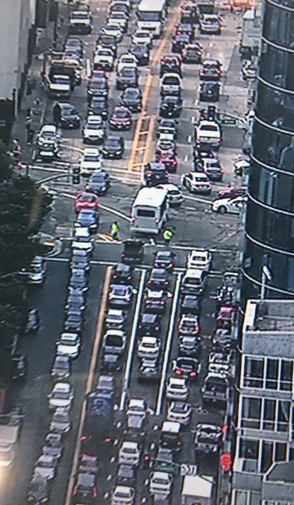 Traffic cops directing traffic on SF 1st St leading to Bay Bridge. That on-ramp still closed. Turn onto Harrison.