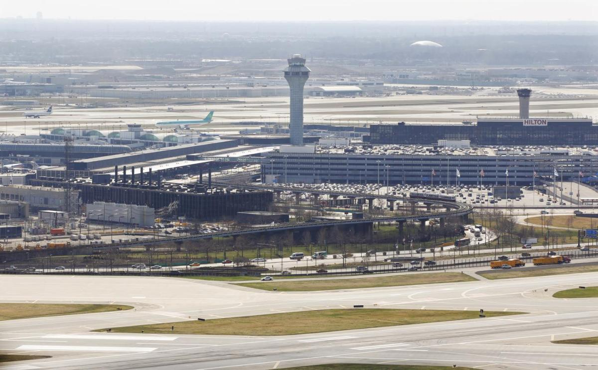 Plane catches fire on runway at Chicago's O'Hare airport