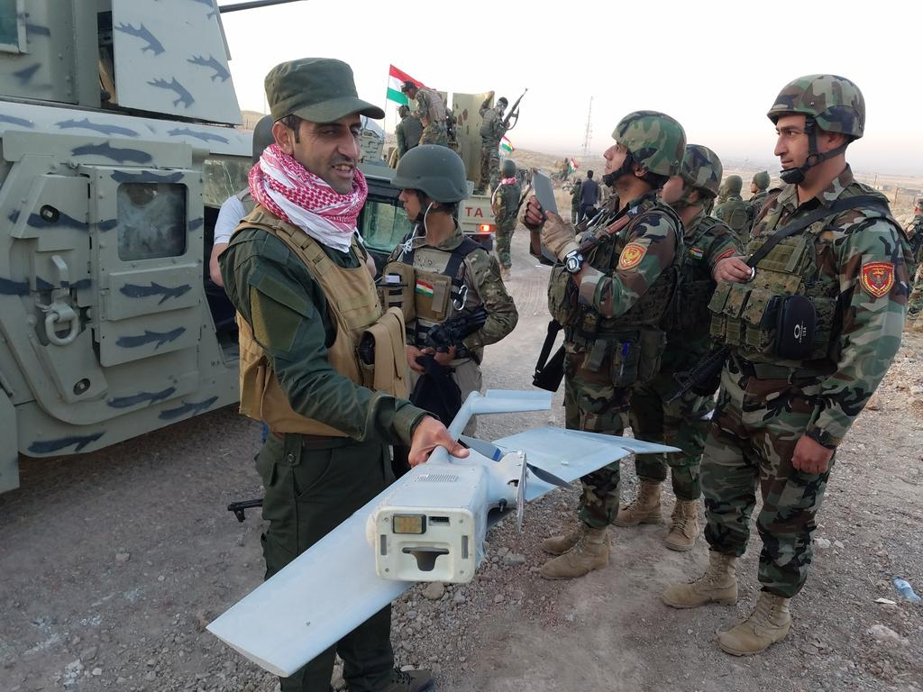 Peshmerga soldier displays remains of ISIS drone near Mosul.
