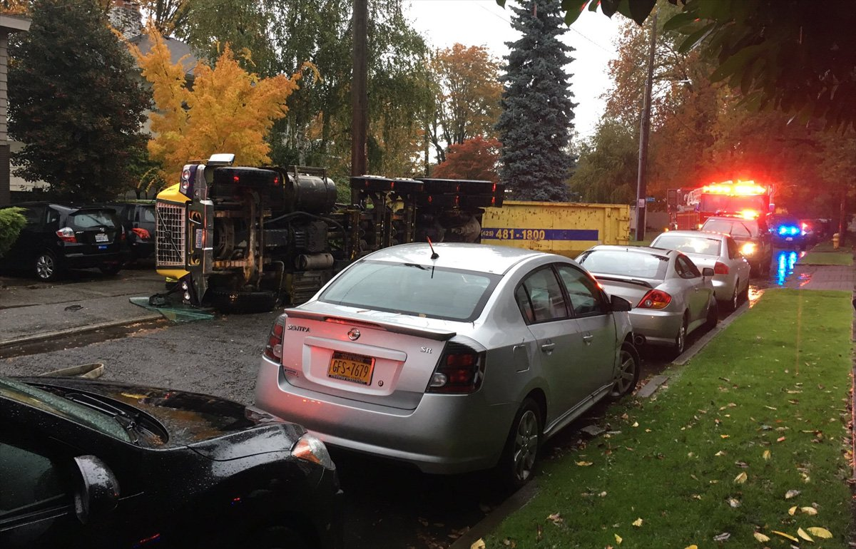 Dump truck overturns in Seattle neighborhood, blocks street -