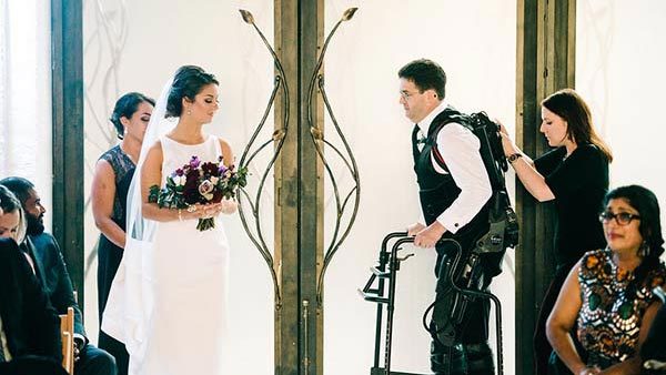 Father walks daughter down aisle using exoskeleton