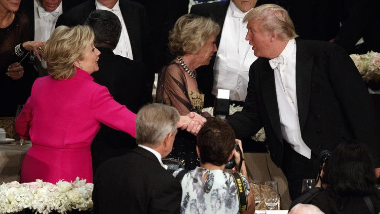 Trump draws boos as he and Clinton trade barbs at roast.