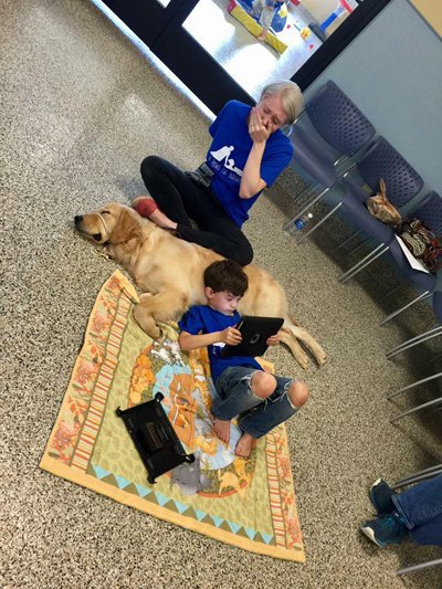 Mother overwhelmed after son with autism curls up with new service dog