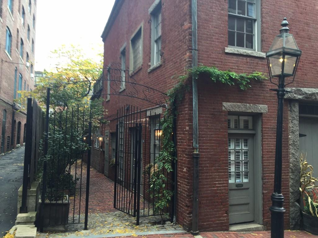 This funky little studio for sale in Beacon Hill is nestled at the end of a brick walkway