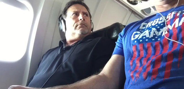 Man Takes Back Middle Seat Armrest From Fellow Passenger