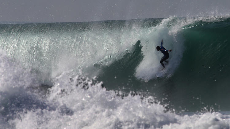 Surfers take to sometimes-tainted water in the name of science