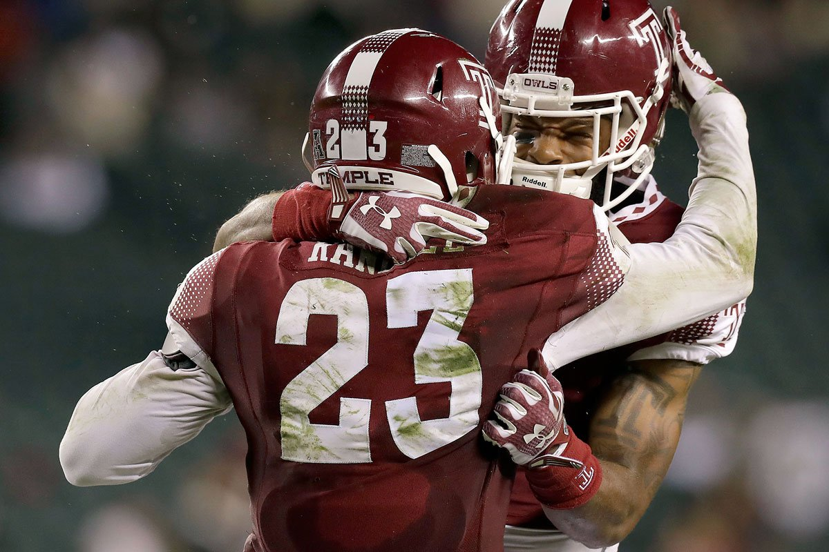 Temple rushes for 319 yards in 46-30 upset of South Florida.
