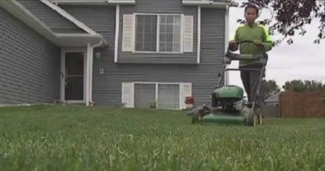 Headstone placed on father's grave after boy mowed lawns to buy it