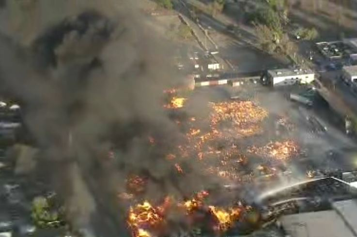 Fire crews begin to get handle on flames at Ontario recycling center. WATCH
