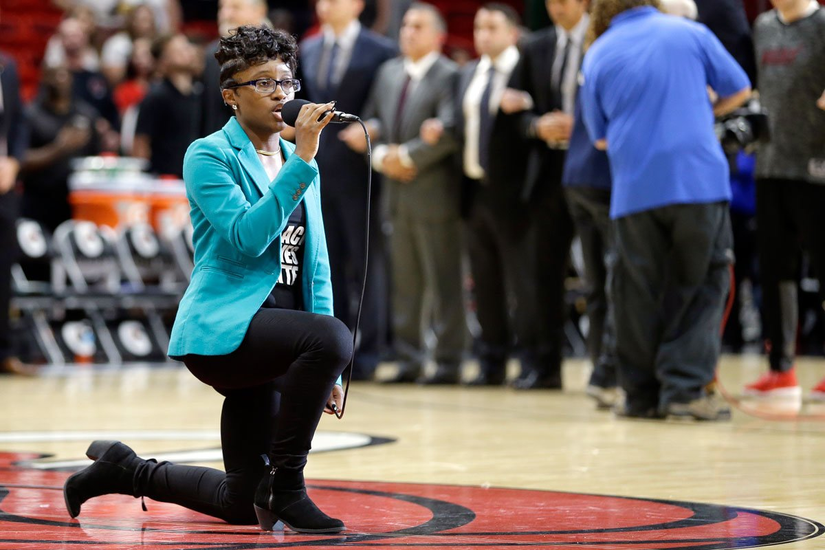Anthem singer at 76ers game kneels during performance.