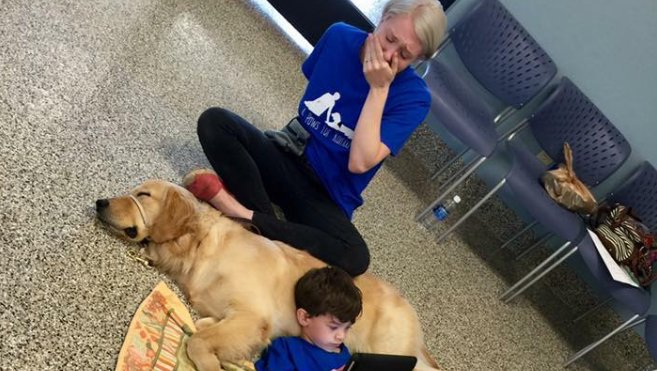 Mother overwhelmed with emotion after son with autism curls up with new service dog