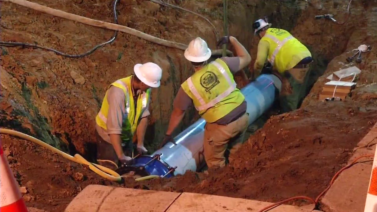 Crews are working to fix a broken water main that flooded 12 homes in Oakland.
