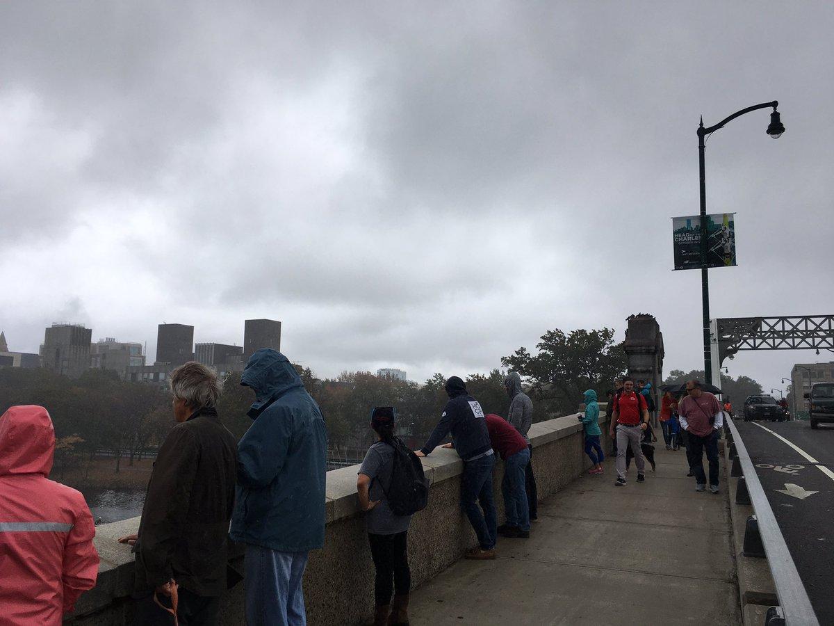 The diehard spectators on the Boston University Bridge just a few minutes ago during pouring rain HOCR52